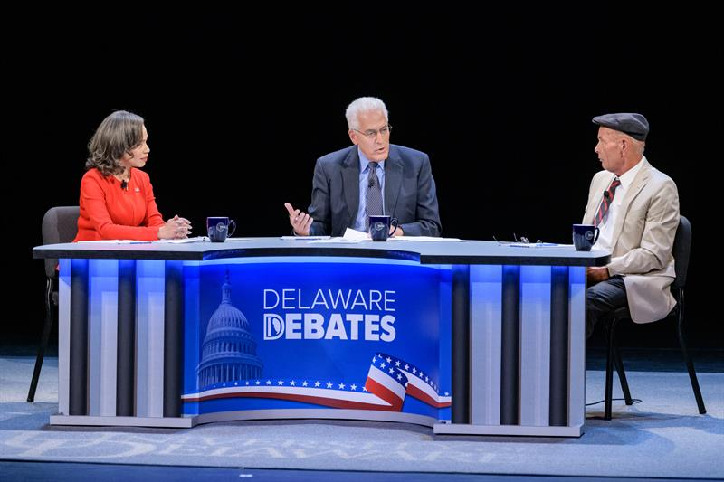 Ralph Begleiter (center) moderates a debate with the candidates for Delaware's seat in the U.S. House of Representatives: incumbent Lisa Blunt Rochester and challenger Scott Walker.